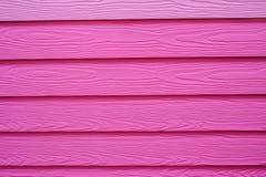 被构造的桃红色木墙壁 免版税图库摄影