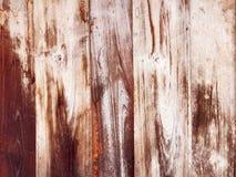 被构造的背景的布朗木墙壁 免版税库存图片