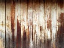 被构造的背景的布朗木墙壁 免版税库存照片