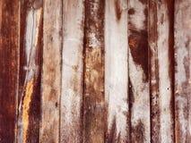 被构造的背景的布朗木墙壁 库存照片