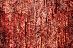 被构造的血淋淋的老红色难看的东西墙壁 被构造的被烧的木墙壁 免版税库存照片