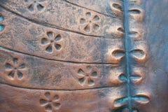 被构造的铜抽象派花卉绘画 库存照片