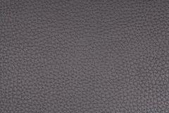 被构造的黑色人造皮材料 免版税库存图片