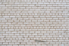 被构造的破裂的白色难看的东西砖墙 免版税库存图片