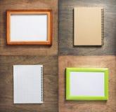 被检查的笔记本和画框在木头 库存照片