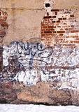 被毁坏的墙壁背景墙壁油漆街道画 免版税库存图片
