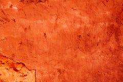 被毁坏的橙色装饰膏药的纹理 r 免版税库存图片