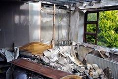 被毁坏的火家 免版税库存照片