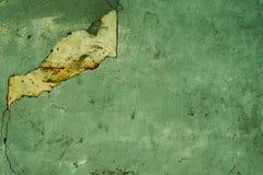被毁坏的绿色装饰膏药纹理  r 免版税库存照片