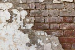 被毁坏的膏药墙壁或水泥砖墙纹理难看的东西背景 免版税库存图片