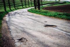 被毁坏的路在乡下 库存图片