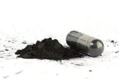 被激活的碳胶囊 免版税库存图片