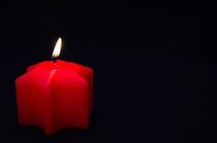 被点燃的一蜡烛 免版税库存照片