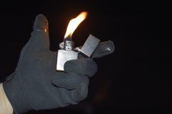 被点燃的打火机 免版税库存图片