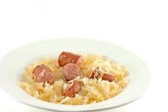 被烘烤的德国泡菜和Kielbasa 免版税图库摄影