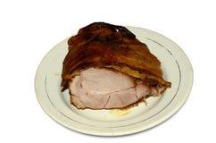 被烘烤的查出的猪肉 库存图片