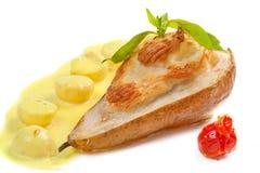 被烘烤的梨用乳酪 免版税库存照片