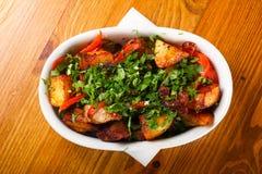 被烘烤的猪肉用土豆 库存图片
