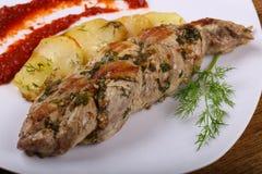 被烘烤的猪肉用土豆 免版税库存图片