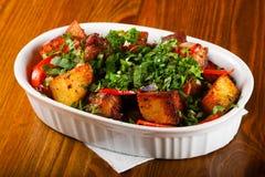 被烘烤的猪肉用土豆 库存照片