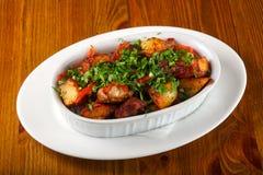 被烘烤的猪肉用土豆 免版税图库摄影