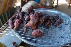 被烘烤的白薯小山部落 图库摄影