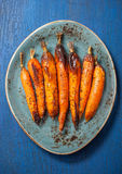 被烘烤的红萝卜 库存照片