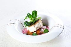 被烘烤的鱼土豆 图库摄影