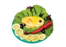 被烘烤的鱼蔬菜 库存照片
