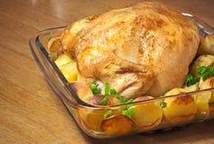 被烘烤的鸡土豆 库存图片
