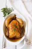 被烘烤的鸡用草本 免版税库存照片