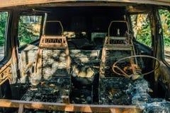 被烧光的汽车,里面看法 免版税库存照片