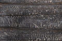 被烧焦的黑木墙壁 库存照片