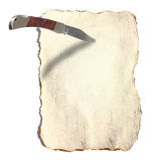 被烧的刀子纸张 免版税库存照片