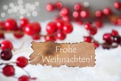 被烧的标签,雪, Bokeh,文本Frohe Weihnachten意味圣诞快乐 免版税库存图片