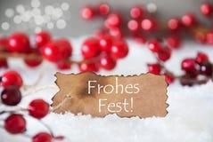 被烧的标签,雪, Bokeh,文本Frohes费斯特意味圣诞快乐 免版税库存照片