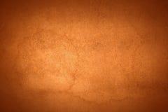 被烧的橙色老背景水污点 免版税库存照片