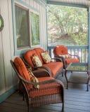 被烧的橙色露台家具外面在甲板 库存照片