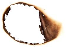 被烧的漏洞纸张 免版税库存照片