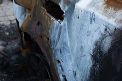 被烧的灰色汽车 免版税库存图片