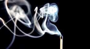被烧的符合抽烟 免版税库存图片