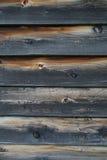 被烧的被风化的木板条特写镜头  免版税库存照片