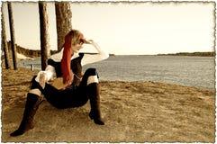 被烧的边缘女孩照片海盗乌贼属serie 库存照片