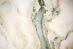 被照亮的切片大理石石华 水平的图象 温暖的绿色 背景的美好的关闭 图库摄影