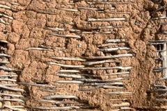 被猛撞的墙壁修建与地球和木板条 图库摄影