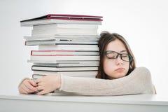 被用尽的少年女孩疲倦于学会 免版税库存图片