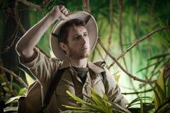 被用尽的探险家在密林 图库摄影