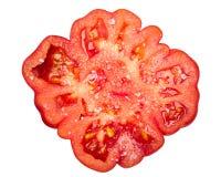 被盐溶的有肋骨蕃茄切片,上面,道路 免版税图库摄影