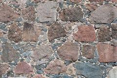 被砍成的石背景 免版税图库摄影