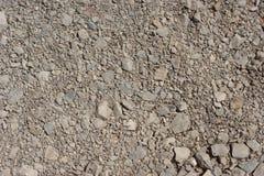 被砸紧的石渣的图片或各种各样的粒度被击碎的石头  库存图片